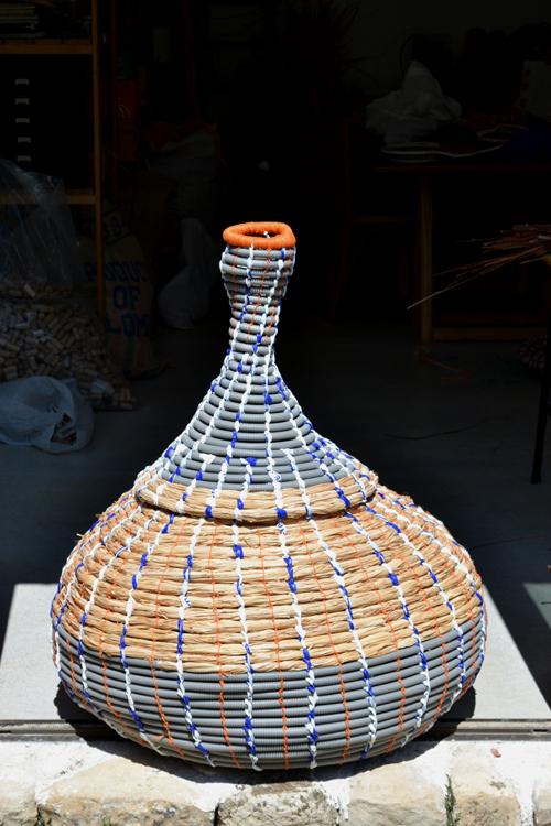 2011 Plastic tube, gladioli leaves, found plastic and string. 100 x 86cm